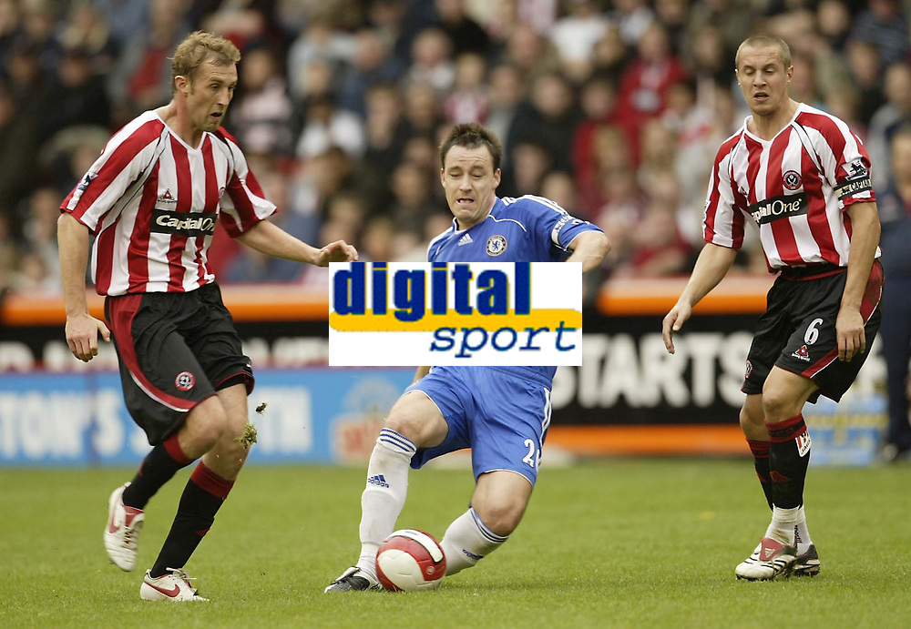 Photo: Aidan Ellis.<br /> Sheffield United v Chelsea. The Barclays Premiership. 28/10/2006.<br /> Chelsea's John Terry gets in between Sheffield's Rob Hulse (L) and Phil Jagielka
