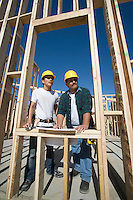 Construction workers standing on building site