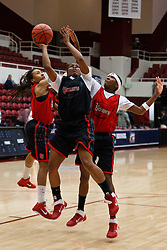March 18, 2011; Stanford, CA, USA; St. John's Red Storm guard Keylantra Langley (center) shoots between guard Sky Lindsay (left) and guard Shenneika Smith (right) during practice the day before the first round of the 2011 NCAA women's basketball tournament at Maples Pavilion.