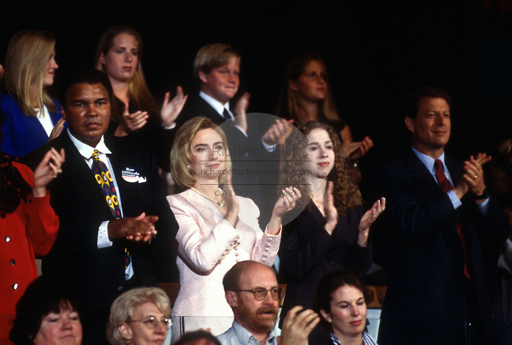 First Lady Hillary Clinton with daughter Chelsea, boxer Mohammed Ali and Vice President Al Gore during President Bill Clinton's acceptance speech the Democratic National Convention August 29, 1996 in Chicago, IL.