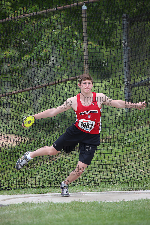 Cole Candella of St Marcellinus SS -Mississauga competes in the midget boys discus at the 2013 OFSAA Track and Field Championship in Oshawa Ontario, Thursday,  June 6, 2013.<br /> Mundo Sport Images / Sean Burges