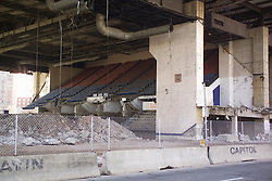 "Razing the New Haven Coliseum. Deconstruction Project as seen on 13 April 2006 from Crown Street. North West Elevation showing under garage steel detail, HVAC, seating, support piers, venue ceiling and the parking garage above. The Garage was eventually ""Imploded"" to ground level for removal."
