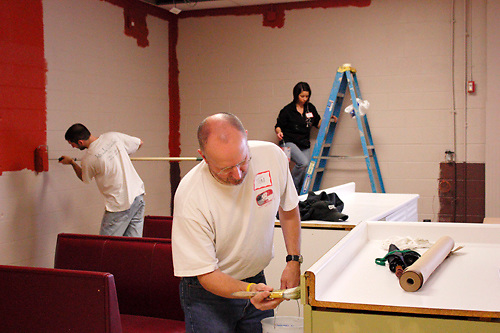 (from left) Marty Wunderink of Vandalia, Tim Ortlieb of Piqua and Jody Willoughby of Tipp City .help the Ginghamsburg Church create a new church on East Main Street in Trotwood, Saturday, February 4, 2012.  The church church will share space with the YMCA, in partnership with the YWCA Neighborhood Development Association.