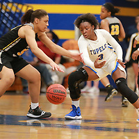Tupelo's Che'mya Carouthers tries to knock the away and get a quick steal on defense by the lady waves as they try to comeback against Hernando Thursday night.