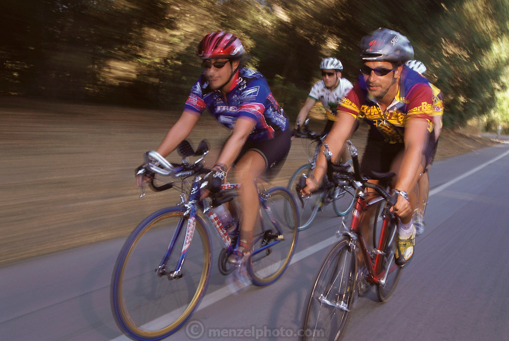 Silicon Valley, California; Start-up asimba.com; CEO Scott Hublou (on right) biking, Los Altos, Iron-man training 6:50 am. (1999).