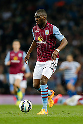 Christian Benteke of Aston Villa makes a break goin on to score his second goal to make it 2-1 - Photo mandatory by-line: Rogan Thomson/JMP - 07966 386802 - 07/04/2015 - SPORT - FOOTBALL - Birmingham, England - Villa Park - Aston Villa v Queens Park Rangers - Barclays Premier League.