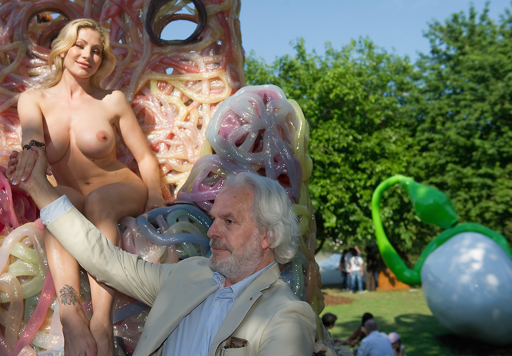 VENICE, ITALY - JUNE 02:    (EDITORS NOTE: Image contains nudity.) Gianni de Luigi  stands in front of porn star Vittoria Risi sited naked on a chair by Gaetano Pesce at the Italian Pavillion on June 2, 2011 in Venice, Italy. This year's Biennale is the 54th edition and will run from June 4th until 27 November.