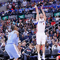 15 April 2014: Los Angeles Clippers guard J.J. Redick (4) takes a jump shot during the Los Angeles Clippers 117-105 victory over the Denver Nuggets at the Staples Center, Los Angeles, California, USA.