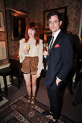Singer FLORENCE WELCH and STUART HAMMOND at a party to celebrate the publication of Imperial Bedrooms by Bret Easton Ellis held at Mark's Club, 46 Charles Street, London W1 on 15th July 2010.