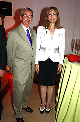 MR JOHN GREY and MARIA SHAMMAS at a party to celebrattte the 150th anniversary of Kensington Palace Gardens in aid of the British Red Cross held at The Orangery, Kensington Palace, London on 7th July 2004.