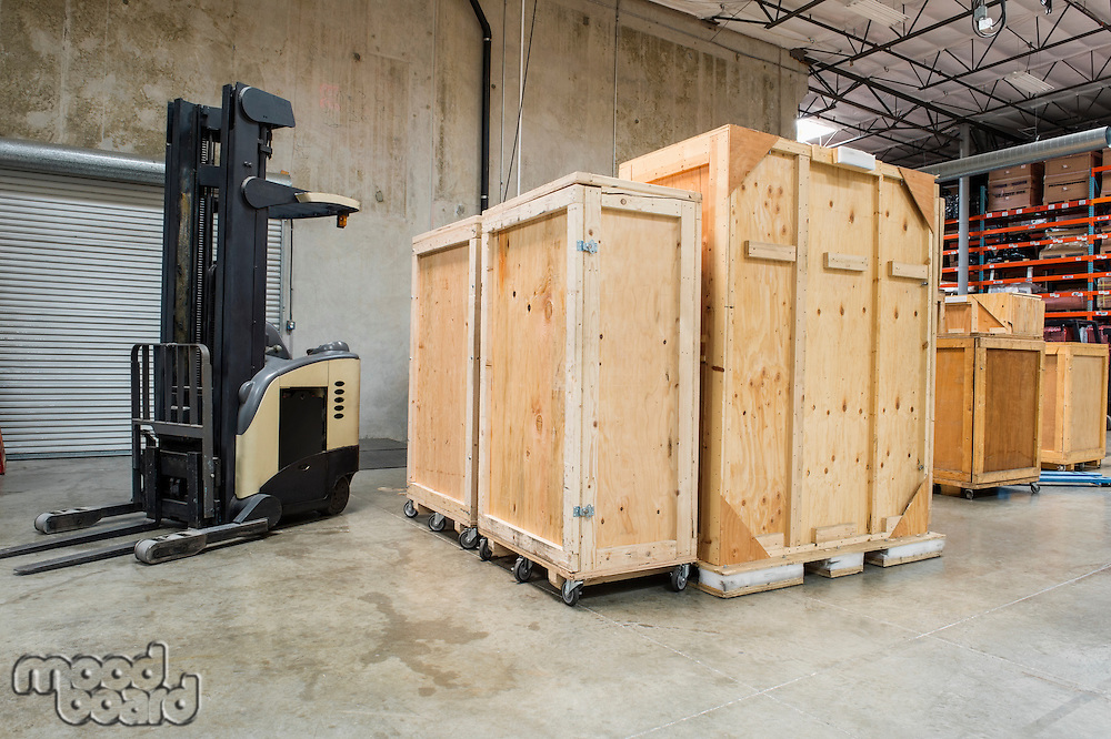Forklift and wooden containers in manufacturing industry