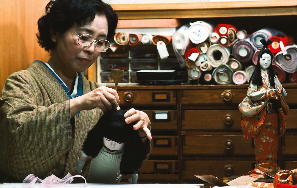 Mrs. Mitsue Shiga a master doll maker working on a Nakayama doll, kimono and hair are made of silk. Kyoto, Japan