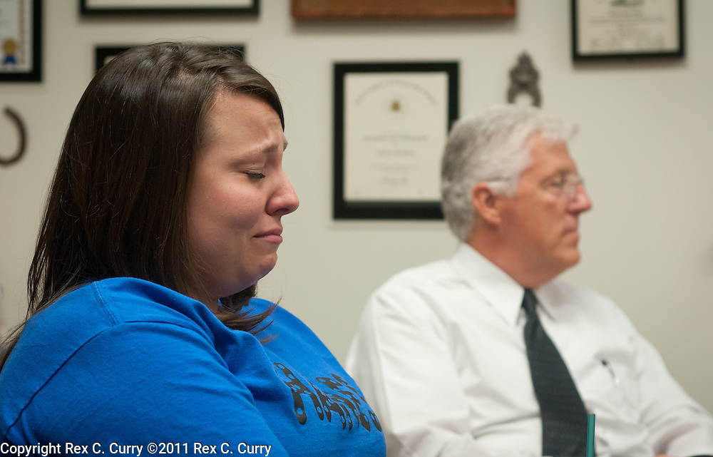 Whitney Bruno, left, Camden Pierce Hughes's kindergarten teacher becomes emotional as she listens to the principal discuss the 6 year old at W.T Hanes Elementary School in Irving, Tx. on May 20, 2011.  At right is J. Pat Lamb, director of security & operations.