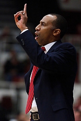 January 27, 2011; Stanford, CA, USA;  Stanford Cardinal head coach Johnny Dawkins calls a play from the bench during the first half against the Oregon Ducks at Maples Pavilion.