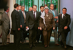 BRUSSELS, BELGIUM - MAY 31, 2001 - Romano Prodi, President of the European Commission (left) escorts Yasser Arafat, leader of the PLO (right)  into the Brydel building at  the European Commission, Thursday. (PHOTO © JOCK FISTICK)