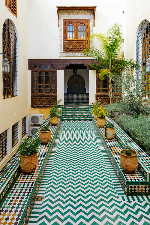 Al-Kairouine Mosque and University, Fez Medina, Morocco, 2018-02-02.<br /> <br /> The Marinid dynasty expanded the Al-Karaouine library in 1359, adding a large space stacked with more than 20,000 hand-written books dating from the early Middle Ages. It also includes 4,000 rare texts and manuscripts.