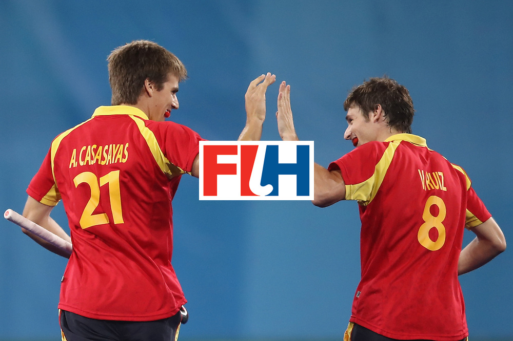 RIO DE JANEIRO, BRAZIL - AUGUST 07:  Alex Casasayas of Spain celebrates with Vicenc Ruiz of Spain after scoring a goal during the men's pool A match between Spain and Australia on Day 2 of the Rio 2016 Olympic Games at the Olympic Hockey Centre on August 7, 2016 in Rio de Janeiro, Brazil.  (Photo by Mark Kolbe/Getty Images)