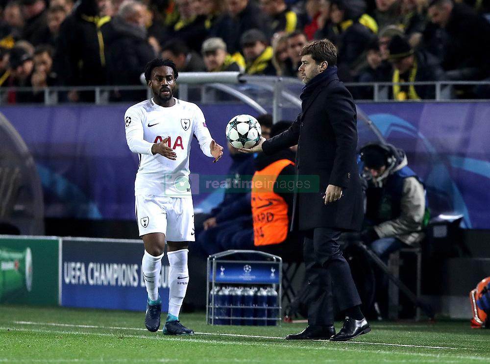 Tottenham Hotspur manager Mauricio Pochettino hands the ball to Tottenham Hotspur's Danny Rose (left)