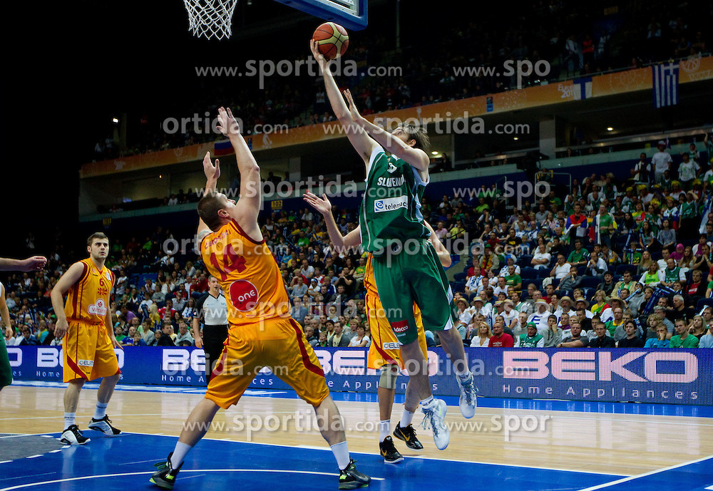 Gjorgij Chekovski of Macedonia vs Erazem Lorbek of Slovenia during basketball game between National basketball teams of F.Y.R. of Macedonia and Slovenia at FIBA Europe Eurobasket Lithuania 2011, on September 10, 2011, in Siemens Arena,  Vilnius, Lithuania.  (Photo by Vid Ponikvar / Sportida)
