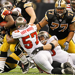 November 6, 2011; New Orleans, LA, USA; Tampa Bay Buccaneers defenders attempt to tackle New Orleans Saints running back Chris Ivory (29) during the third quarter of a game at the Mercedes-Benz Superdome. The Saints defeated the Buccaneers 27-16. Mandatory Credit: Derick E. Hingle-US PRESSWIRE