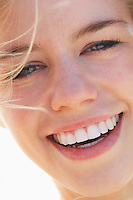 Smiling young woman portrait close-up