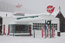 """Snowy Flying A in Truckee 2"" - This snow covered replica of a Flying A gas station was photographed in the early morning in Downtown Truckee, California."