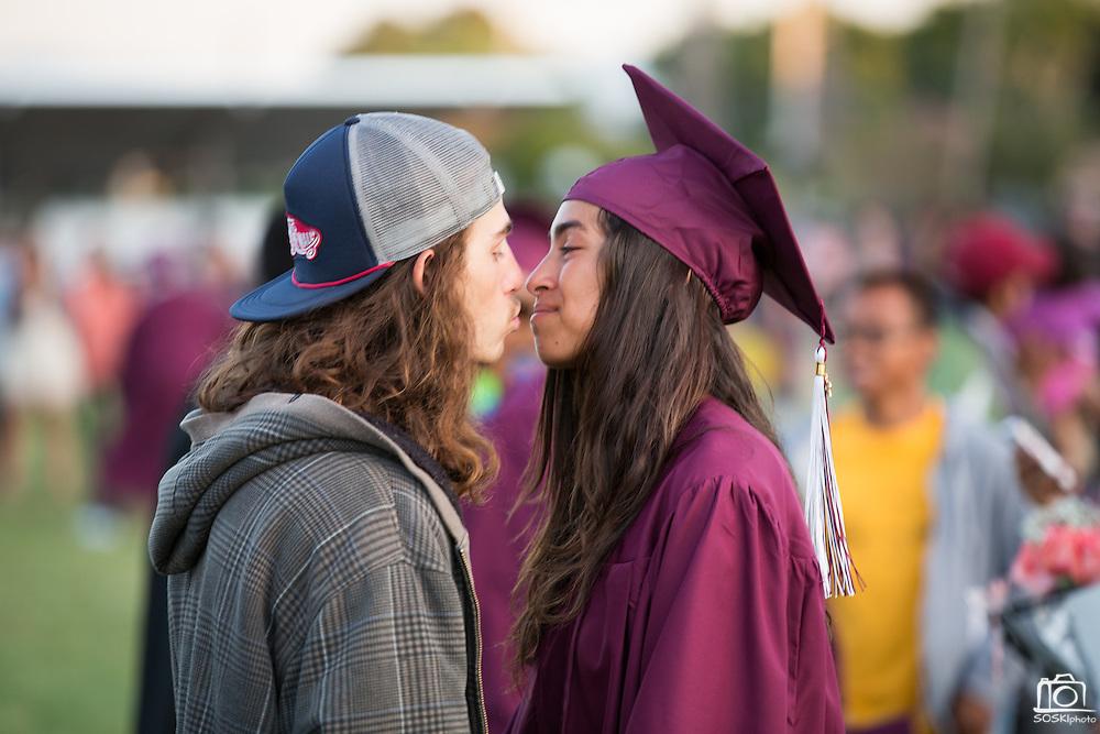 Cal Hills High School senior Cheyenne Aldama kisses her boyfriend Mathew Qumtana after the Class of 2013 graduation at the Milpitas Sports Center in Milpitas, California, on June 6, 2013. (Stan Olszewski/SOSKIphoto)
