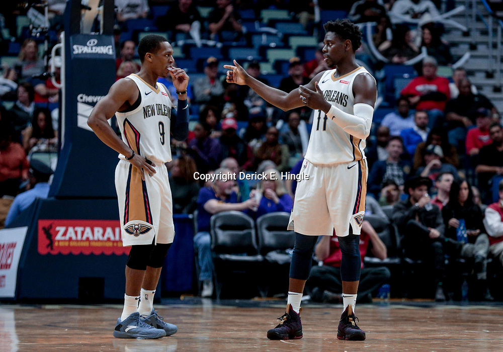 Jan 8, 2018; New Orleans, LA, USA; New Orleans Pelicans guard Rajon Rondo (9) and guard Jrue Holiday (11) talk during the second half against the Detroit Pistons at the Smoothie King Center. The Pelicans defeated the Pistons 112-109. Mandatory Credit: Derick E. Hingle-USA TODAY Sports