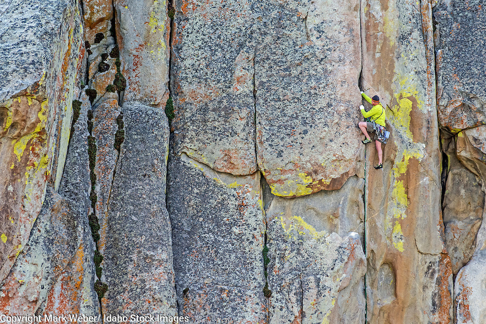 Mark Weber rock climbing a route called Thin Slice which is rated 5,10 and located on Parkinglot Rock at the City Of Rocks National Reserve near the town of Almo in southern Idaho