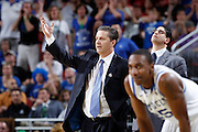 Head coach John Calipari of the Kentucky Wildcats looks on during the game against the Iowa State Cyclones during the third round of the NCAA men's basketball championship on March 17, 2012 at KFC Yum! Center in Louisville, Kentucky. Kentucky advanced with an 87-71 win. (Photo by Joe Robbins)
