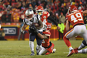 Jan 20, 2019; Kansas City, MO, USA; New England Patriots running back James White (28) battles with Kansas City Chiefs inside linebacker Anthony Hitchens (53) during the AFC Championship game at Arrowhead Stadium. The Patriots defeated the Chiefs 37-31 in overtime to advance to their fifth Super Bowl in eight seasons. (Robin Alam/Image of Sport)