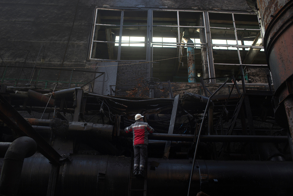 Musa Magomedov, general director of the Metinvest Coke Plant, is seen in an area of the plant that was damaged by shelling on March 18, 2015 in Avdiivka, Ukraine. Shells have hit the property of the plant over 150 times, including multiple hits on the plant itself.