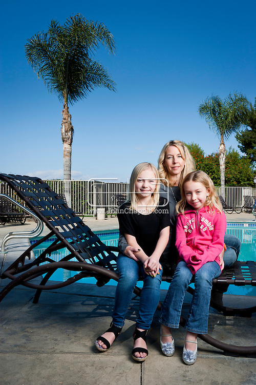February 12th, 2012, Los Angeles, California. Eleven year-old Olivia McKown, a schoolgirl from Norman, Oklahoma. In tow is her mother Liz, 45, a construction worker and younger sister Madeleine, aged eight. PHOTO © JOHN CHAPPLE / www.johnchapple.com.