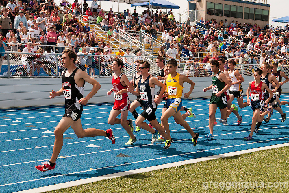 Finishing the first lap of the 1600 meter run (L to R: Eric Storey, Sam Levora, Erik Harris, Alberto De Los Reyes, Ben Stout, and Haydin Herndon) during the 4A Idaho Track and Field Championships on May 19, 2012 at Middleton High School, Middleton, Idaho.