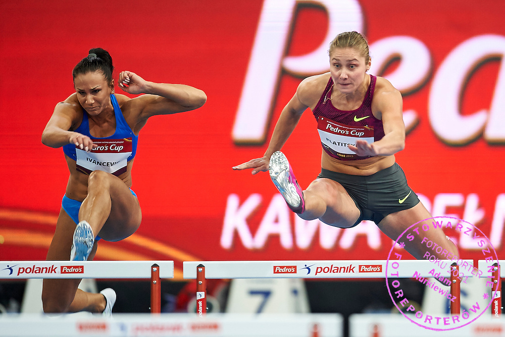 (L) Andrea Ivancevic from Croatia and (R) Hanna Platitsina from Ukraine compete in women's 60 meters hurdles competition during athletics meeting Pedro's Cup at Atlas Arena in Lodz, Poland.<br /> <br /> Poland, Lodz, February 17, 2015<br /> <br /> Picture also available in RAW (NEF) or TIFF format on special request.<br /> <br /> For editorial use only. Any commercial or promotional use requires permission.<br /> <br /> Adam Nurkiewicz declares that he has no rights to the image of people at the photographs of his authorship.<br /> <br /> Mandatory credit:<br /> Photo by &copy; Adam Nurkiewicz / Mediasport