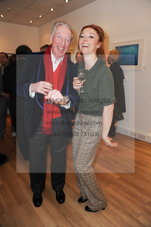 TAMARA BECKWITH and her father PETER BECKWITH at a private view of photographs held at the Little Black Gallery, Park Walk, London on 20th January 2010.
