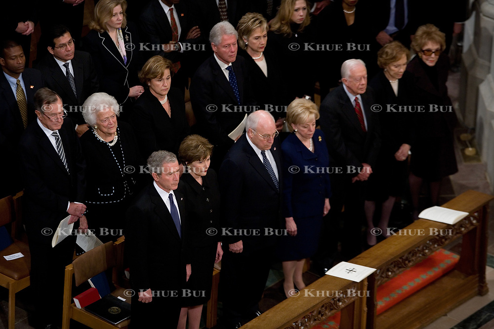 Pres. Bush and First Lady Laura Bush attend funeral services for former Pres. Gerald Ford at the National Cathedral in Washington, Tuesday, Jan. 2, 2007.  left to right (Front Row) Pres. Bush, First Lady Laura Bush, VP Cheney, wife Lynne Cheney, former Pres. Jimmy Carter, wife Rosalynn Carter, Nancy Reagan. (2nd Row) Pres. George H. W. Bush, wife Barbara, daughter Doro Koch, Pres. Clinton, Sen. Hillary Clinton (D-NY), daughter Chelsea Clinton, Sec. of State Rice.<br /> <br /> Photo by Khue Bui