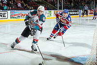 KELOWNA, CANADA - FEBRUARY 22: Davis Koch #16 of the Edmonton Oil Kings back checks Gordie Ballhorn #4 of the Kelowna Rockets as he skates with the puck behind the net during second period on February 22, 2017 at Prospera Place in Kelowna, British Columbia, Canada.  (Photo by Marissa Baecker/Shoot the Breeze)  *** Local Caption ***