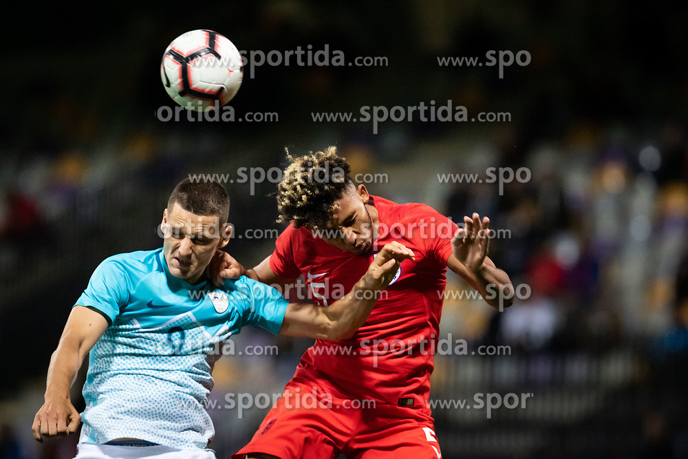 Žan Celar of Slovenia and Lloyd Kelly of England during friendly Football match between U21 national teams of Slovenia and England, on October 11, 2019 in Ljudski Vrt, Maribor, Slovenia. Photo by Blaž Weindorfer / Sportida