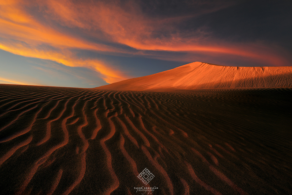 During a short trip to the nearest desert from where I live, I was surprised from the reflection of sunset colors on this dune, and I loved it so much.