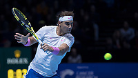 Tennis - 2019 Nitto ATP Finals at The O2 - Day Two<br /> <br /> Singles Group Andre Agassi: Rafael Nadal (Spain) Vs. Alexander Zverev (Germany)<br /> <br /> A focused Rafael Nadal (Spain) returns the with a backhand <br /> <br /> COLORSPORT/DANIEL BEARHAM<br /> <br /> COLORSPORT/DANIEL BEARHAM