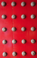 Red door decoration with brass knobs in Singapore