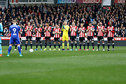 Brentford FC players holding a minutes applause before kick off in memory of the late Ray Wilkins during the EFL Sky Bet Championship match between Brentford and Ipswich Town at Griffin Park, London, England on 7 April 2018. Picture by Andy Walter.