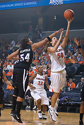 Virginia forward Chelsea Shine (50) finishes a layup past High Point forward Ashlee' Samuels (54).  The #15 ranked Virginia Cavaliers defeated the High Point Panthers 78-48 in NCAA Women's Division 1 Basketball at the John Paul Jones Arena on the Grounds of the University of Virginia in Charlottesville, VA on November 14, 2008.
