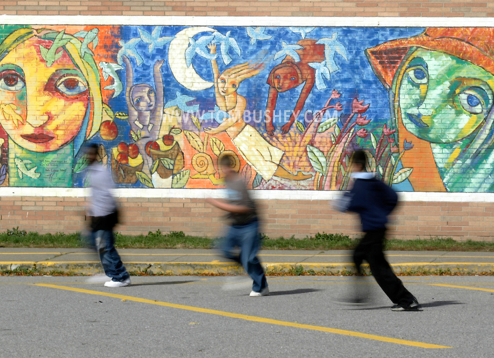 Students play in front of a mural at Temple Hill Academy in New Windsor on Oct. 24, 2007.