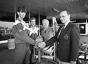 Irish Squash Team Return From Singapore. (T8)..1989..20.10.1989..10.20.1989..20th October 1989..The Irish squash team arrived home from Singapore where the World Squash Championships were held...Pictured on their arrival at Dublin Airport the Irish Squash team were met by David Whyte, Douglas ,Cork the Hon Treasurer of the Irish Squash Racket Association. From Left, Derek Ryan, Graeme Stewart and Michael Magee, President,Irish Squash Racket Association.