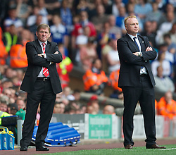 LIVERPOOL, ENGLAND - Saturday, April 23, 2011: Liverpool's manager Kenny Dalglish and Birmingham City's manager Alex McLeish during the Premiership match at Anfield. (Photo by David Rawcliffe/Propaganda)