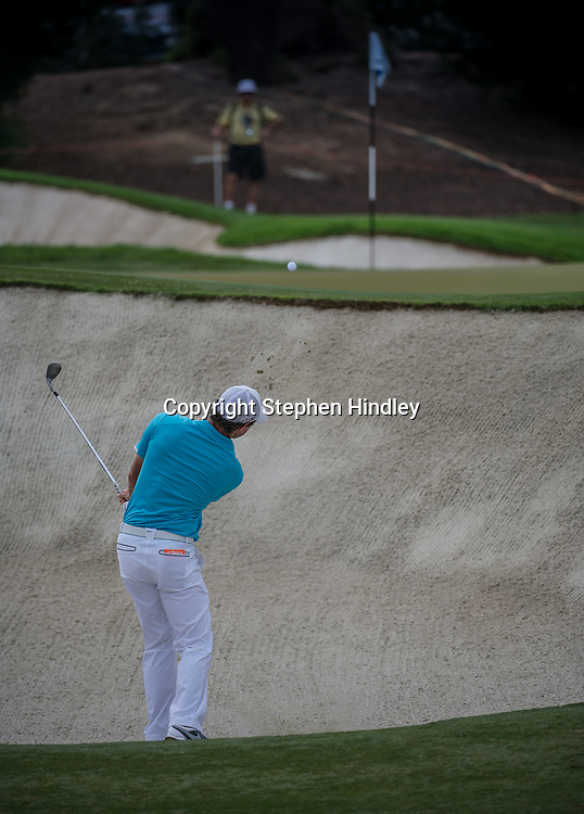 Rory McIlroy of Northern Ireland plays a shot from the bunker frist green during the final round of the DP World Tour Championship held at the Jumeirah Golf Estates in Dubai, United Arab Emirates, on Sunday, November 17, 2013.  Photo by: Stephen Hindley/SPORTDXB