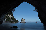 A calm blue dawn at Cathedral Cove, half an hour before the rising sun.