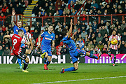 GOAL 1-0 Brentford striker Neal Maupay (9) shoots and scores during the EFL Sky Bet Championship match between Brentford and Bolton Wanderers at Griffin Park, London, England on 22 December 2018.
